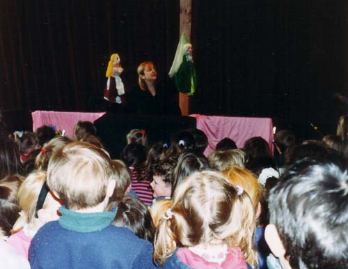 Claire entertaining children with puppets in Cinderella